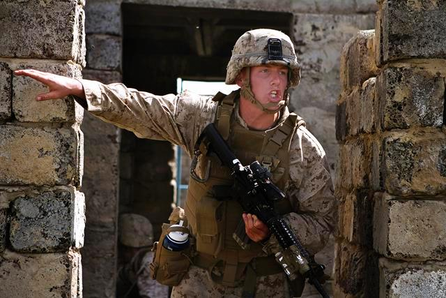 U.S. Marine Corps Lance Cpl. Nicholas Moore shouts orders to his team during a cordon and search event during Exercise Khaan Quest 2013 at Five Hills Training Area in Mongolia, Aug. 08, 2013.