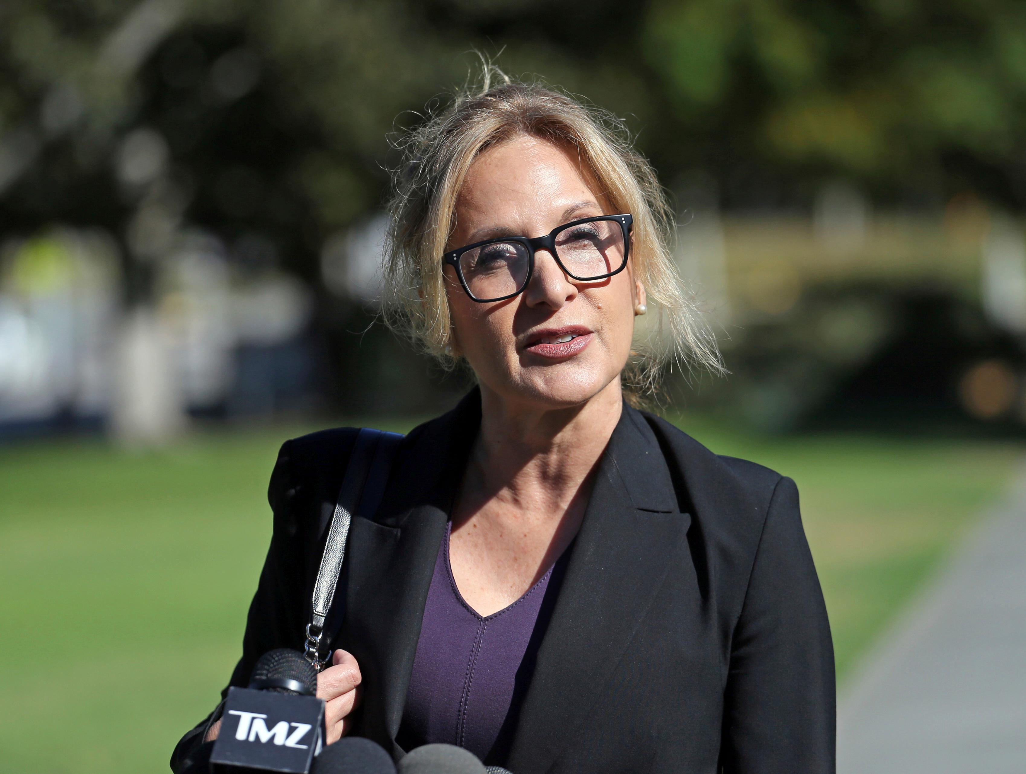 Angela Agrusa, attorney for entertainer Bill Cosby, who is accused of sexual assault by Judy Huth at the Playboy Mansion more than 40 years ago, speaks outside Los Angeles Superior Court after a hearing, Tuesday, June 27, 2017, in Santa Monica, Calif. The purpose of the hearing was to set a trial date in the civil case. (AP Photo/Reed Saxon)