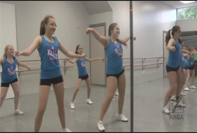 Dancers from Vancil Performing Arts Center practicing for Indy 500 parade performance.