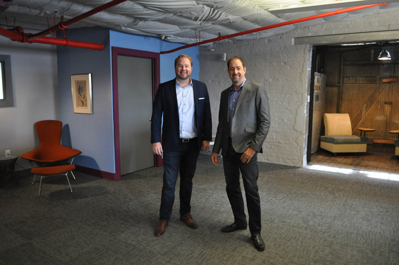 Alex Taylor and Tim Haines recently acquired Oval Room Group from its original investor, Ted Dahmus. The two have extensive experience in commercial real estate and want to put the Cincinnati-based company on a national stage. / Image: Liz Engel // Published: 9.17.19