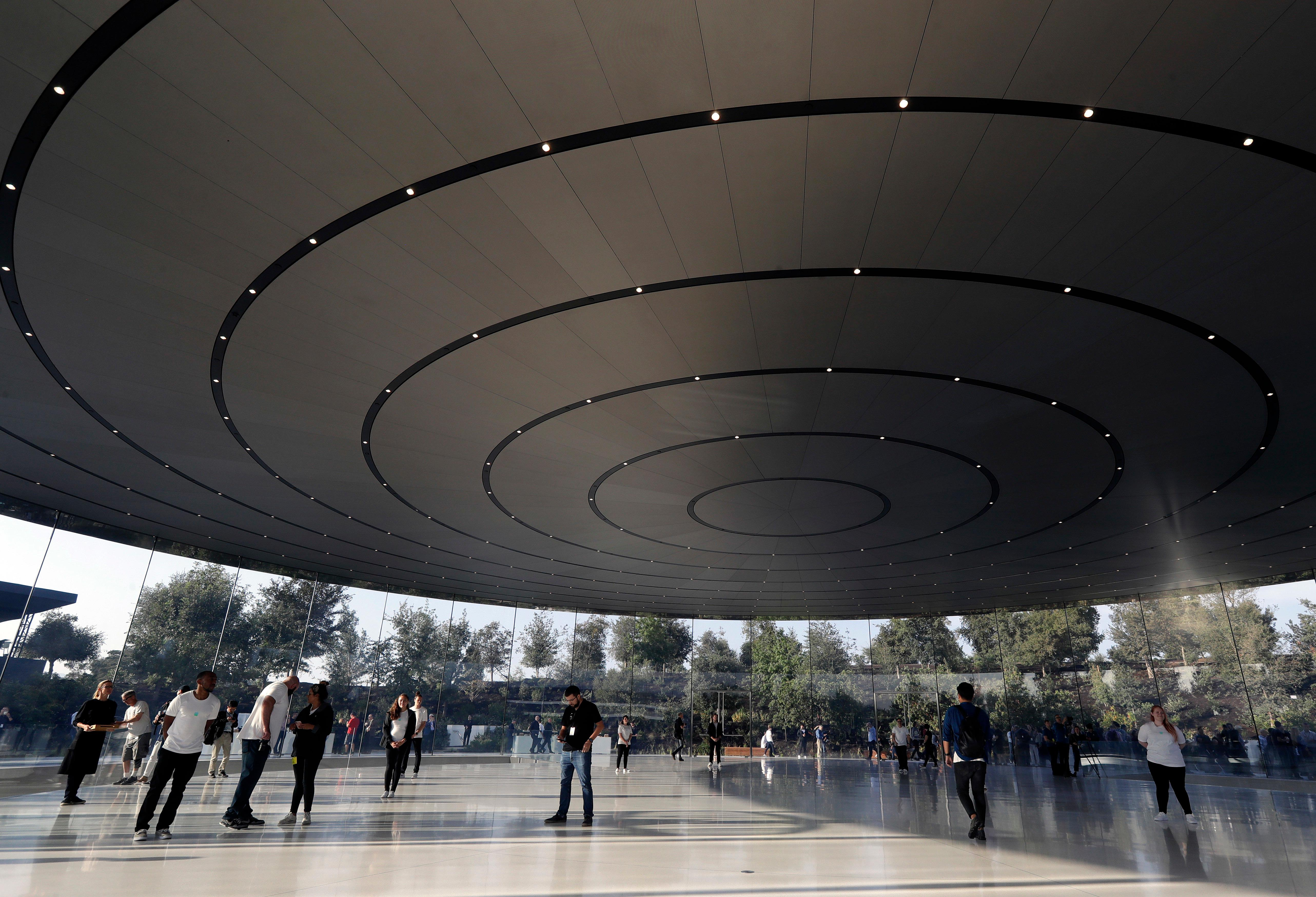 People arrive for a new product announcement at the Steve Jobs Theater on the new Apple campus, Tuesday, Sept. 12, 2017, in Cupertino, Calif. (AP Photo/Marcio Jose Sanchez)