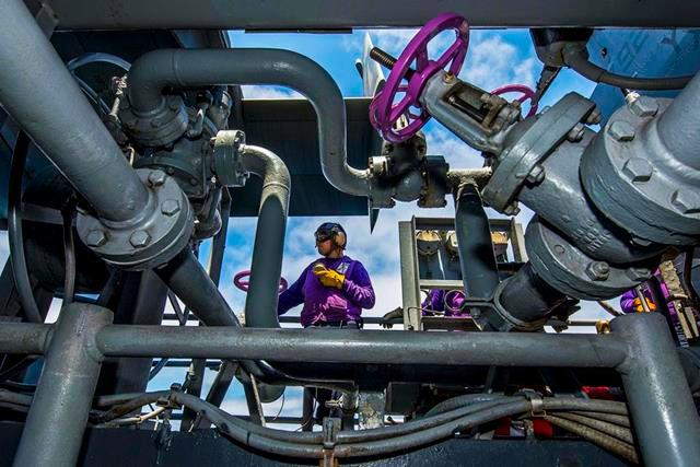 Navy Airman Collin McQueen prepares to fuel aircraft aboard the amphibious assault ship USS Boxer in the Pacific Ocean, Aug. 5, 2013.