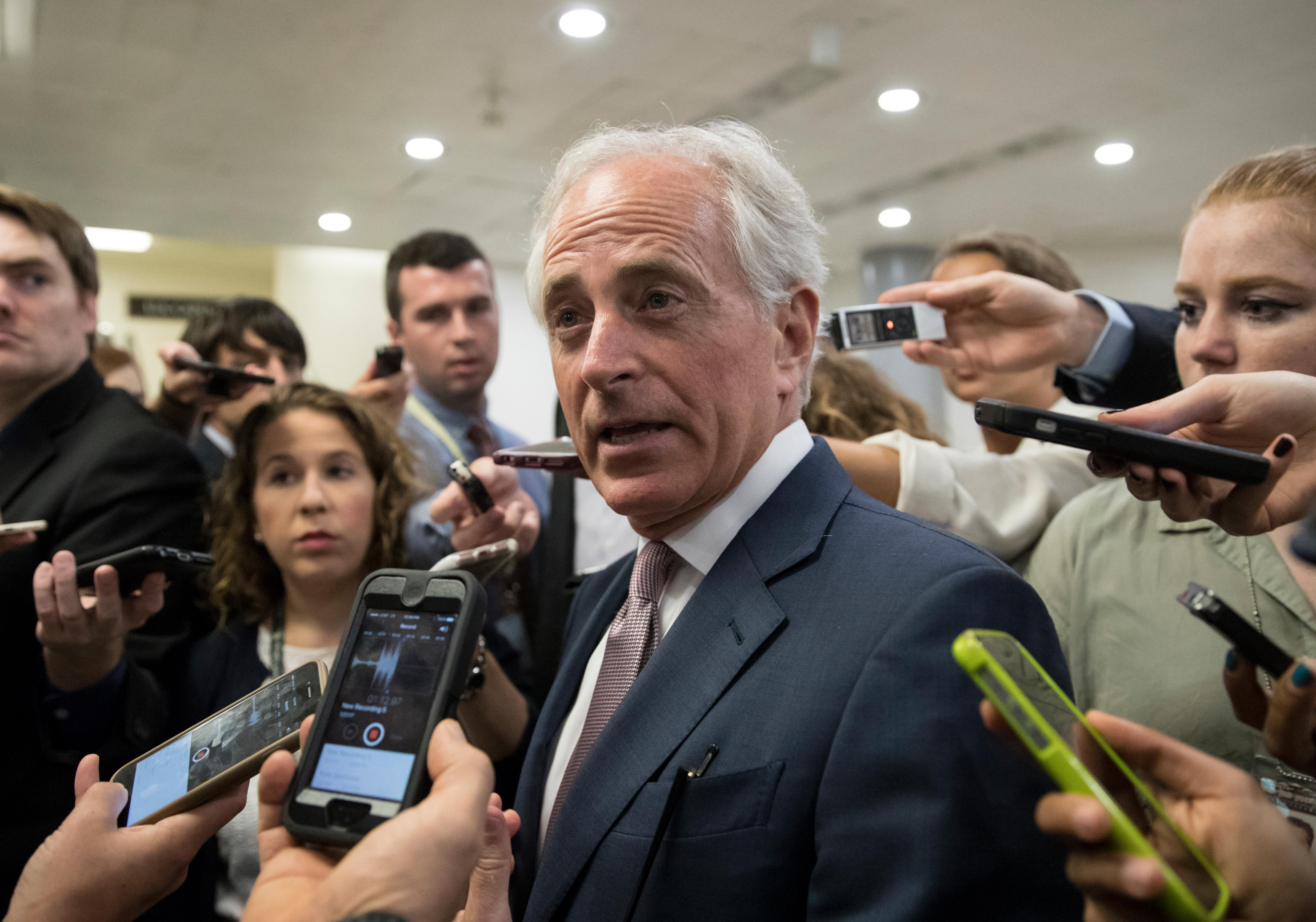 "Sen. Bob Corker, R-Tenn. is surrounded by reporters on Capitol Hill in Washington, Thursday, July 27, 2017, as the Republican majority in Congress remains stymied by their inability to fulfill their political promise to repeal and replace ""Obamacare.""  (AP Photo/J. Scott Applewhite)"