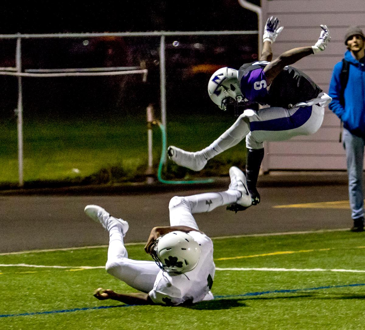 South Eugene's Kelon Logan (#6) jumps over a Sheldon player. Sheldon defeated South 63-6 at South Eugene on Friday. Photo by August Frank, Oregon News Lab