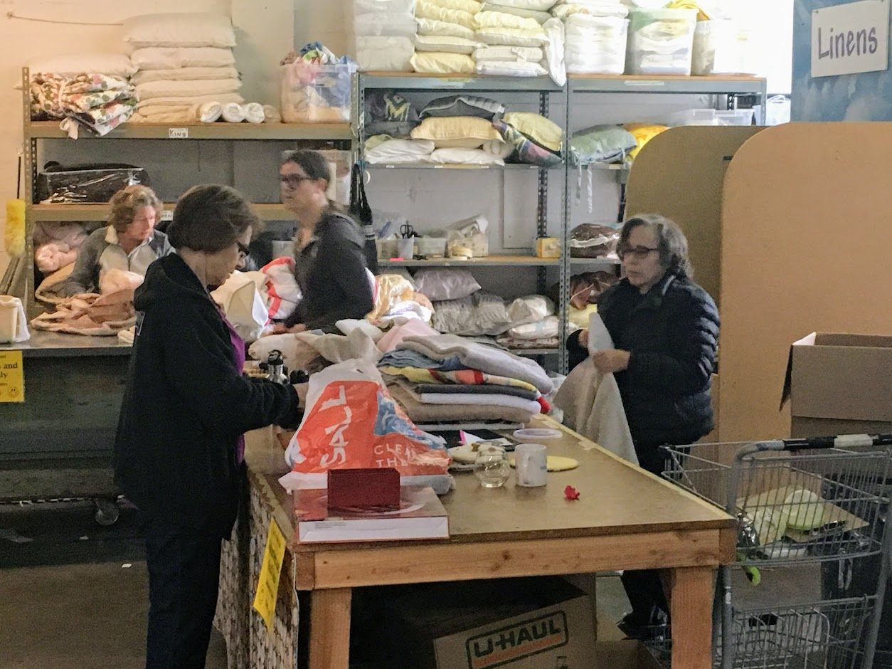 Volunteers sort items coming into the Community Warehouse in Northeast Portland. (KATU)<p></p>