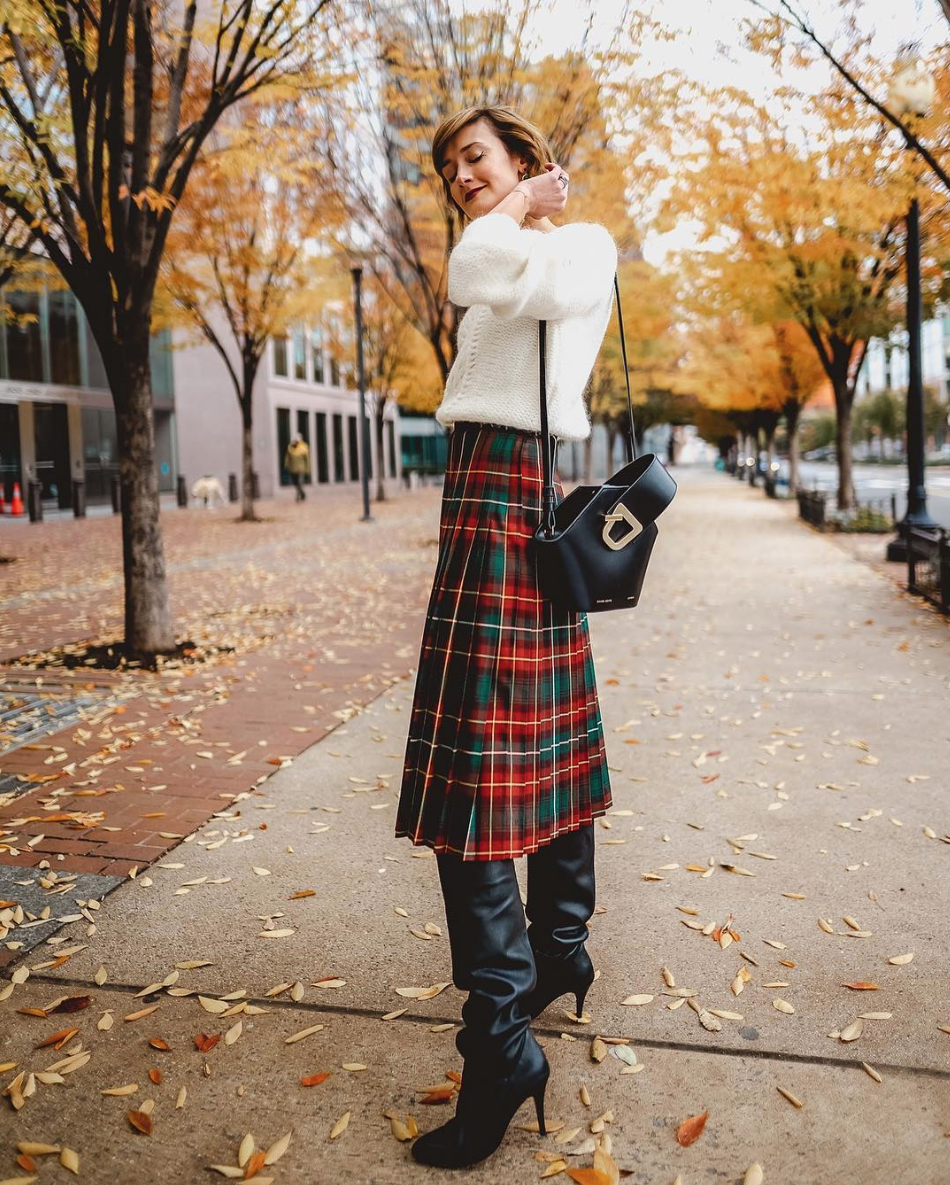 If you're not ready to go all the way bold with your patterns, try to switch up your silhouette instead, like pairing slouchy boots with a longer skirt. (Image via @districtofchic)