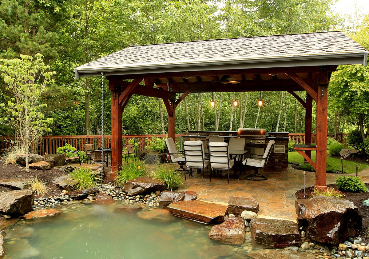 This Newcastle project was completed by Alderwood Landscaping. The total project cost was $105,000.  (Image: Outdoor Living Water Feature and Landscapes / Porch.com)