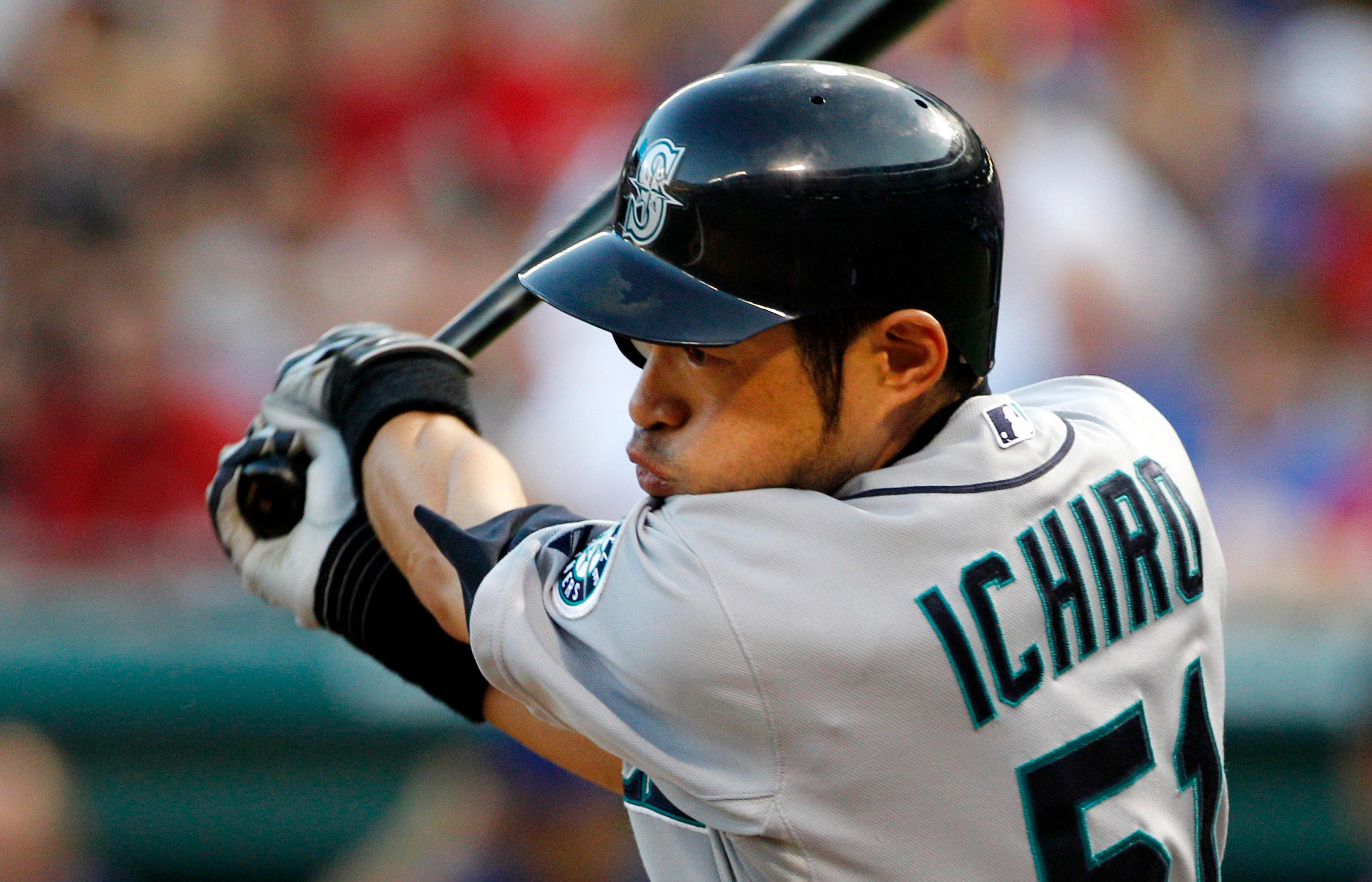 FILE - In this May 29, 2012, file photo, Seattle Mariners' Ichiro Suzuki bats against the Texas Rangers during a baseball game in Arlington, Texas. The Mariners finalized a one-year deal with 44-year-old Japanese star on Wednesday, March 7, 2018, after several outfielders got hurt. (AP Photo/Tony Gutierrez, File)