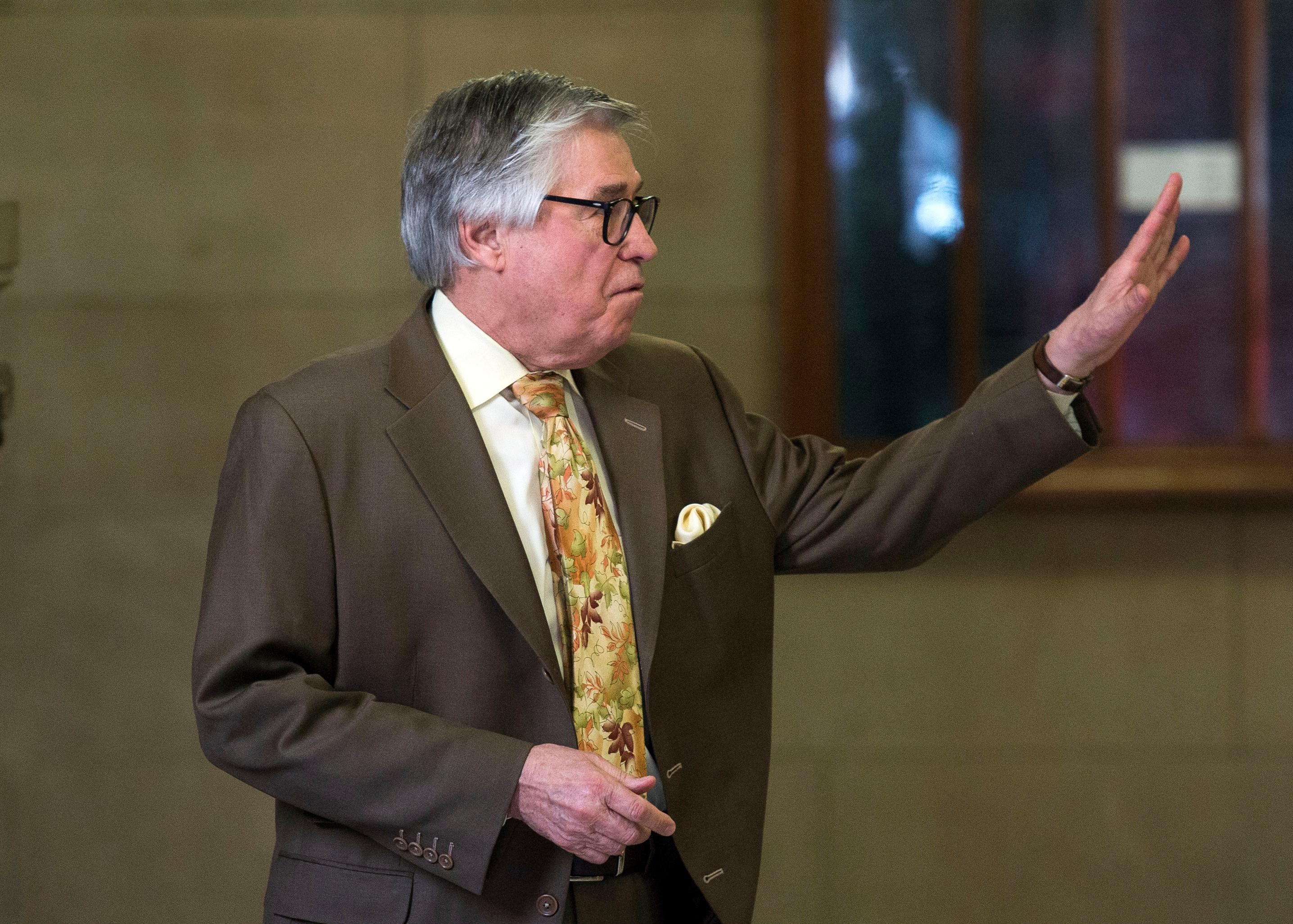 Michael Rosfeld's attorney, Patrick Thomassey, waves to an acquaintance inside Allegheny County Courthouse on a lunch break during the homicide trial of Rosfelt, the former East Pittsburgh police officer, Wednesday, March 20, 2019, Pittsburgh. Rosfeld, 30, faces a charge of criminal homicide for the June 2018 death of 17-year-old unarmed black high school student Antwon Rose II. (Nate Smallwood//Pittsburgh Tribune-Review via AP, Pool)