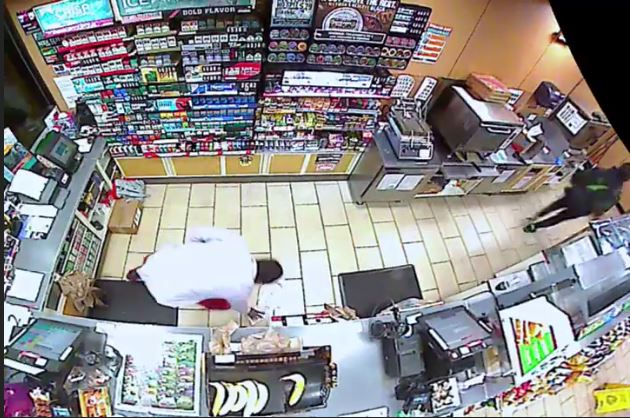 The Broward Sheriff's Office released video of a 7-Eleven clerk stabbing a robber on March 14, 2018, in Pompano Beach. (BSO)