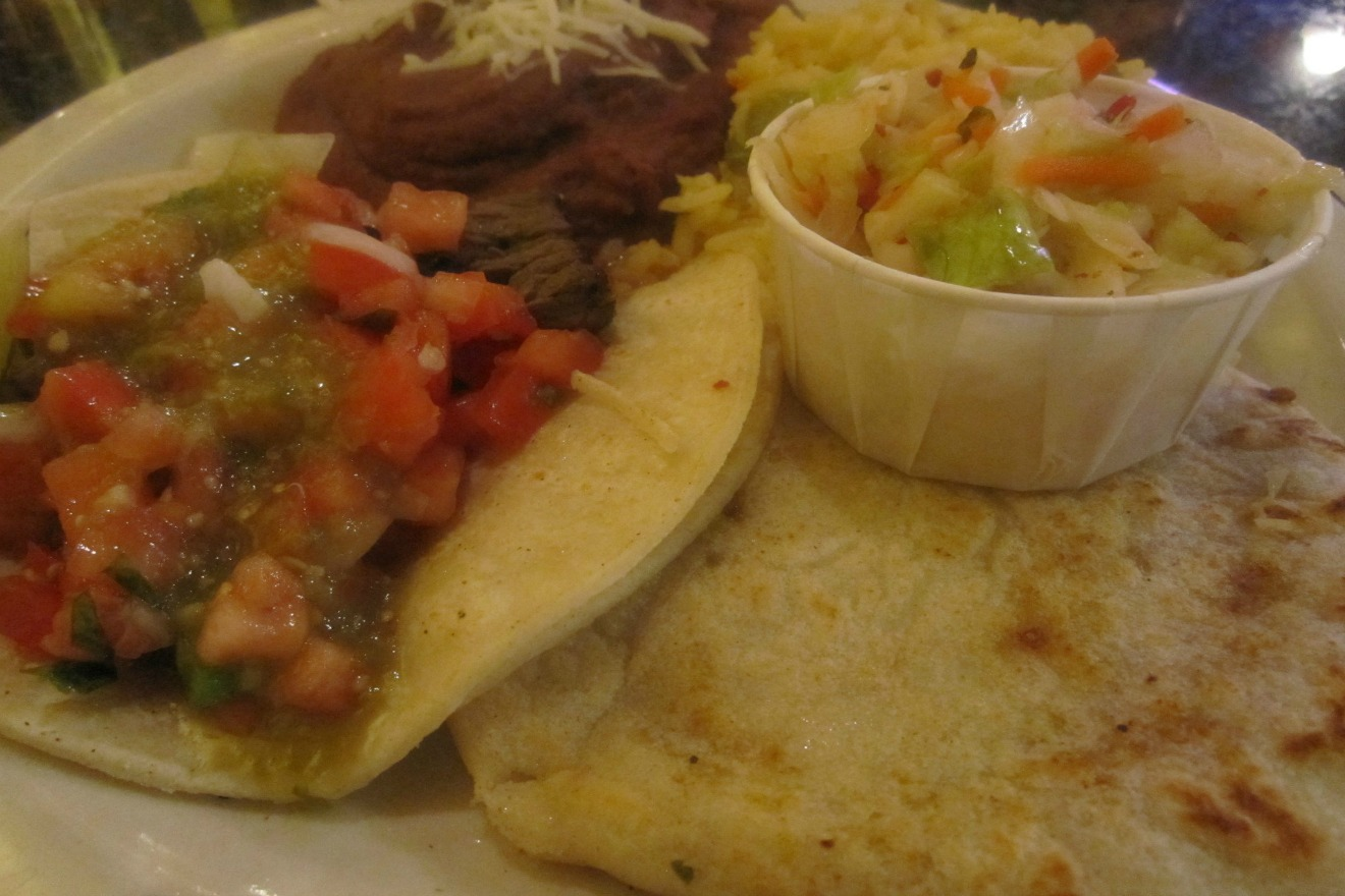 At only $2.90 each, the pupusas at Capitol Hill's Guanaco's Tacos Pupuseria are a cheap way to get full- fast. (Photo Courtesy: Guanaco's Tacos Pupuseria Facebook page)