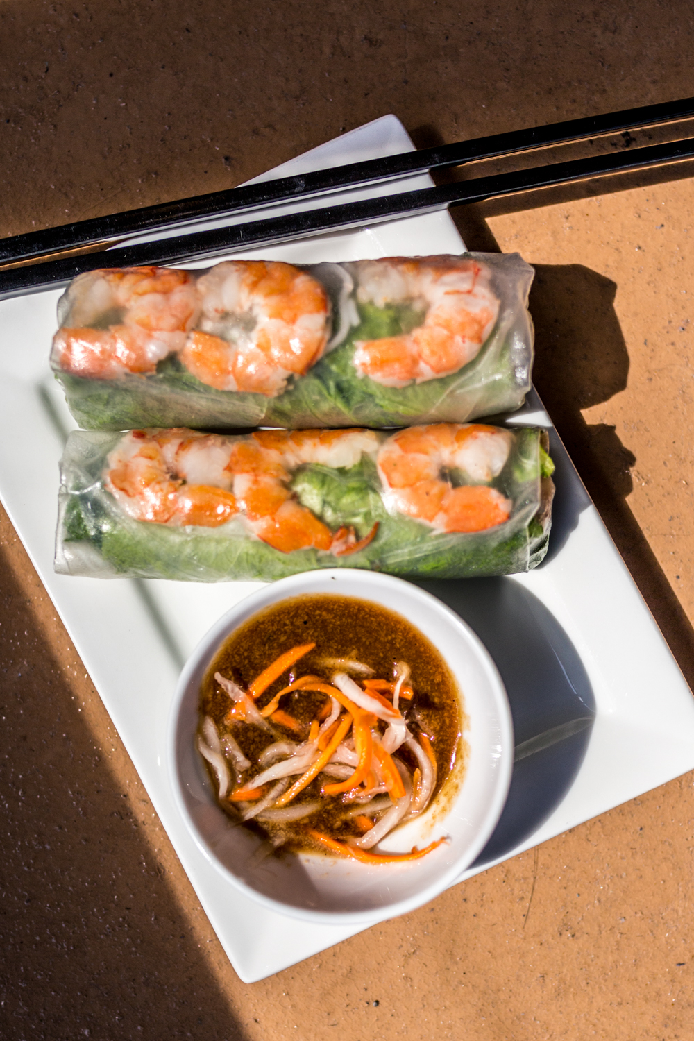 Spring rolls: fresh vermicelli noodles, pork, shrimp, bean sprouts, lettuce, herbs, and served with a peanut dipping sauce / Image: Catherine Viox{ }// Published: 9.28.19