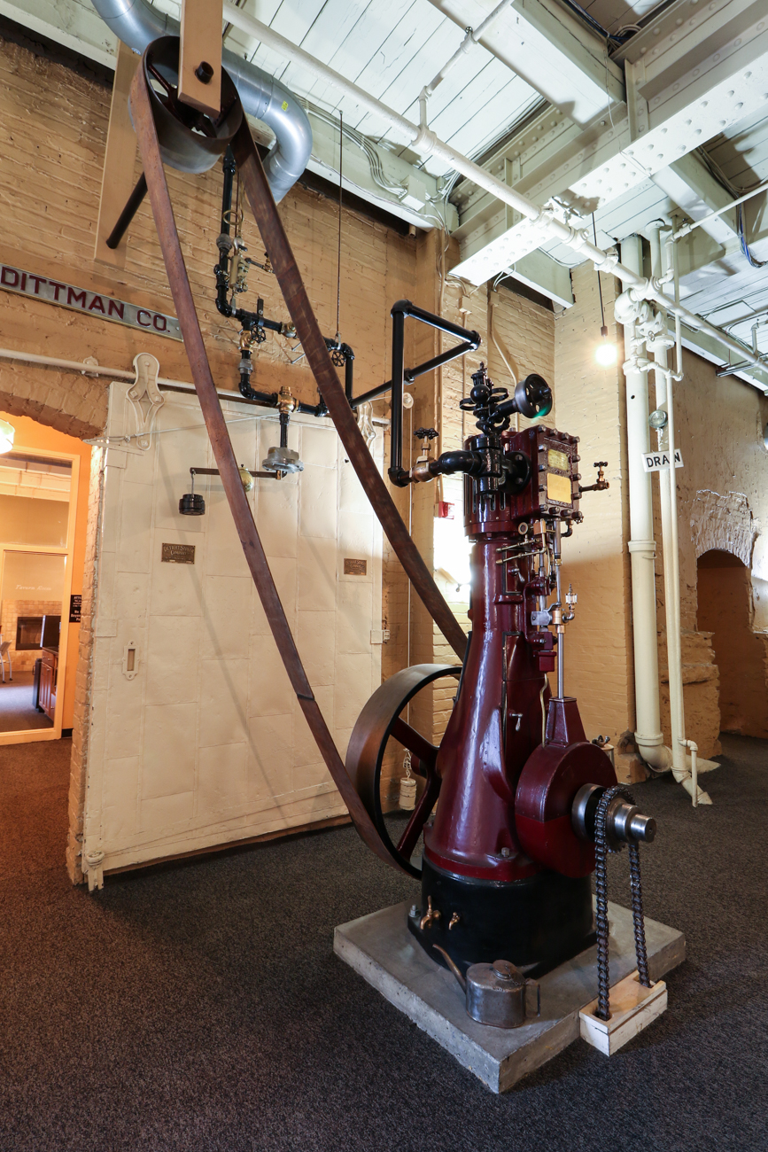 The original steam engine that powered the building's equipment was salvaged during the restoration and now serves as a historic piece in the building's common area. / Image: Ronny Salerno // Published: 2.6.19