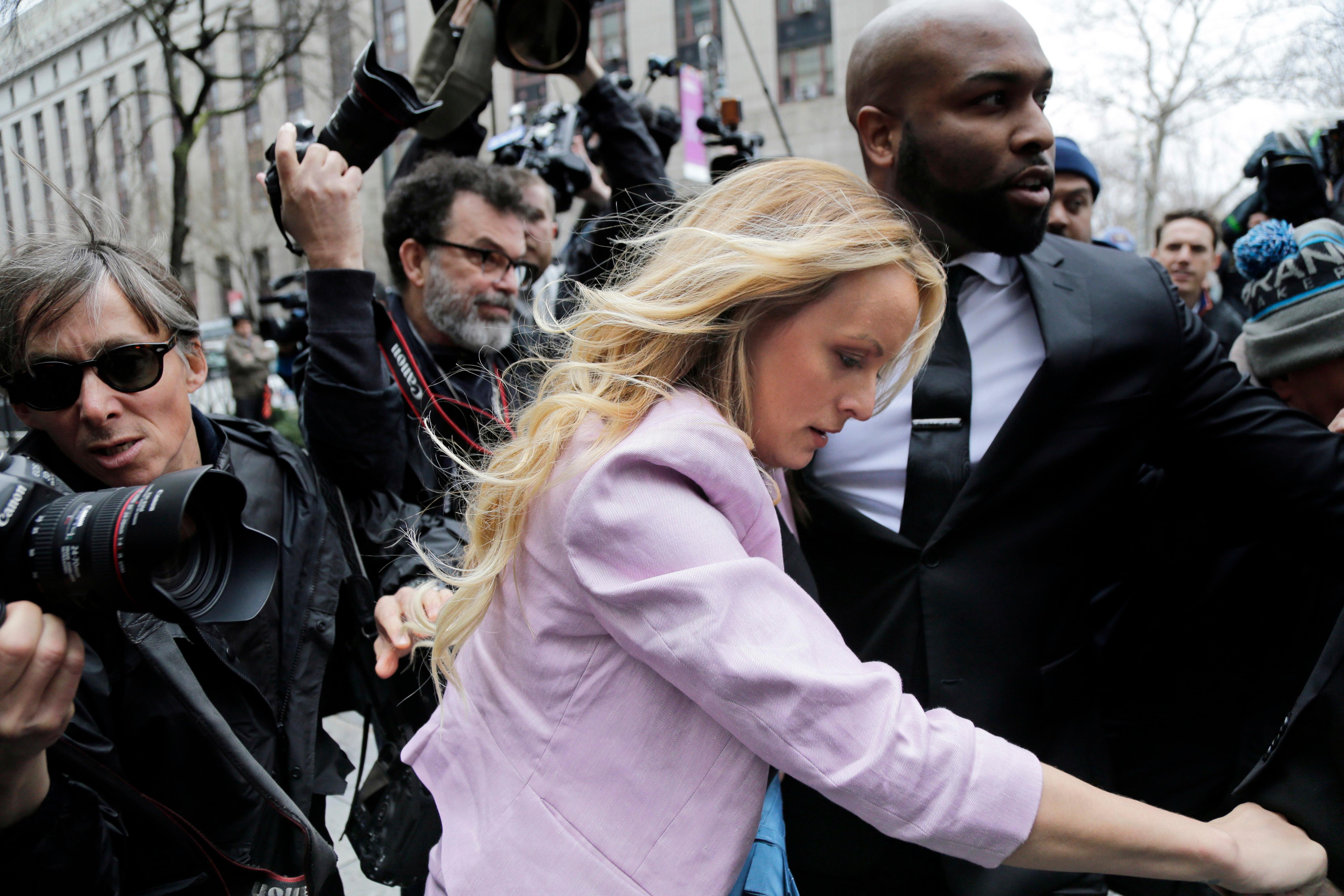 Stormy Daniels arrives at federal court in New York, Monday, April 16, 2018, to attend a court hearing where a federal judge is considering how to review materials that the FBI seized from President Donald Trump's personal lawyer to determine whether they should be protected by attorney-client privilege.(AP Photo/Seth Wenig)