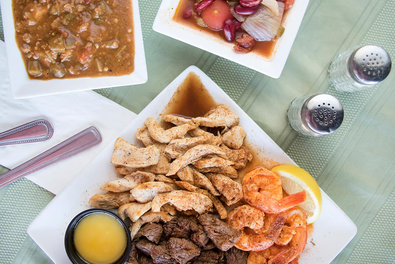 Cajun Sampler: red beans and rice, gumbo, blacked steak strips, blacked chicken strips, and sautéed shrimp / Image: Allison McAdams // Published: 3.7.18