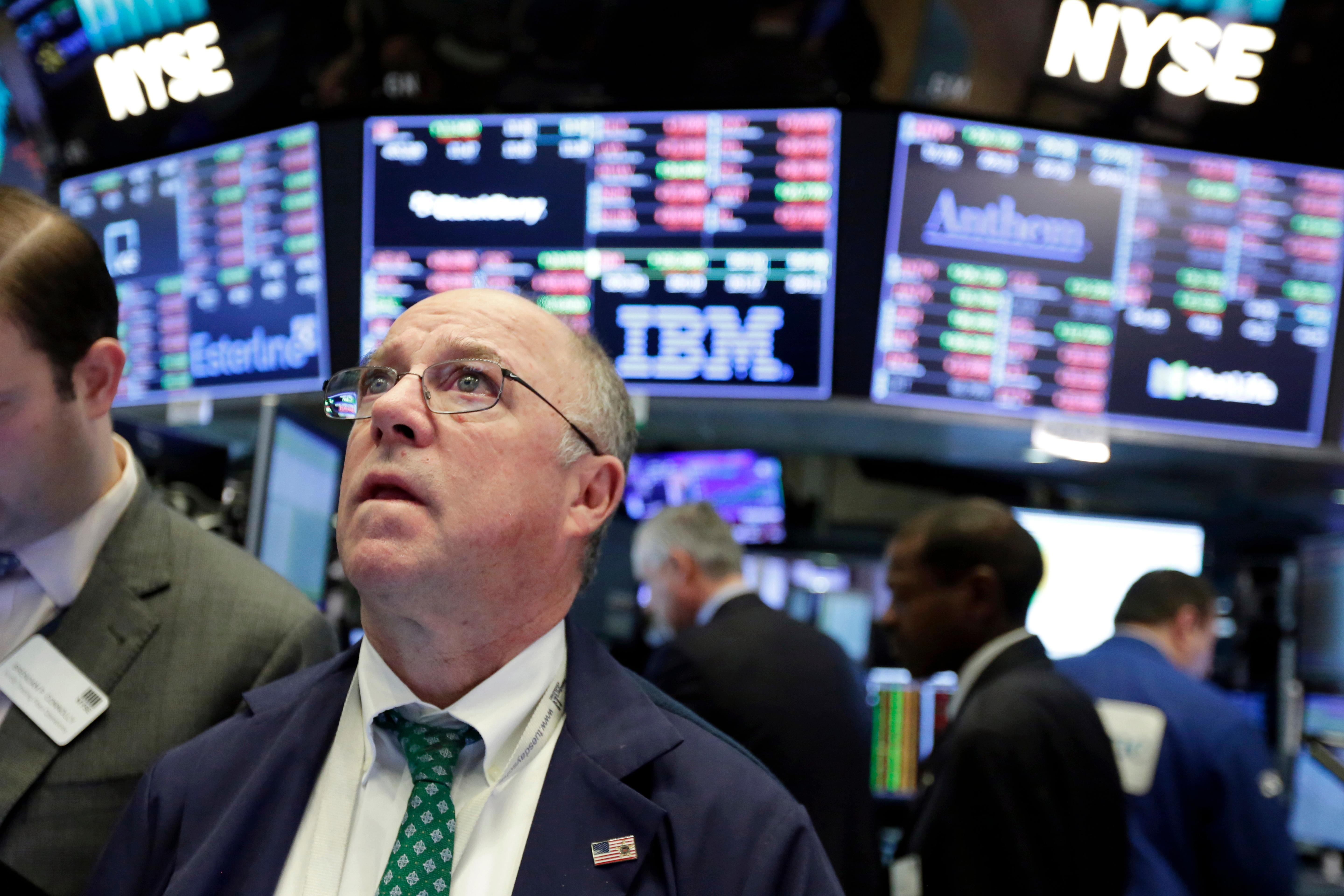 Trader Frederick Reimer works on the floor of the New York Stock Exchange, Tuesday, Feb. 6, 2018. The Dow Jones industrial average fell as much as 500 points in early trading, bringing the index down 10 percent from the record high it reached on Jan. 26.{&amp;nbsp;} (AP Photo/Richard Drew)<p></p>