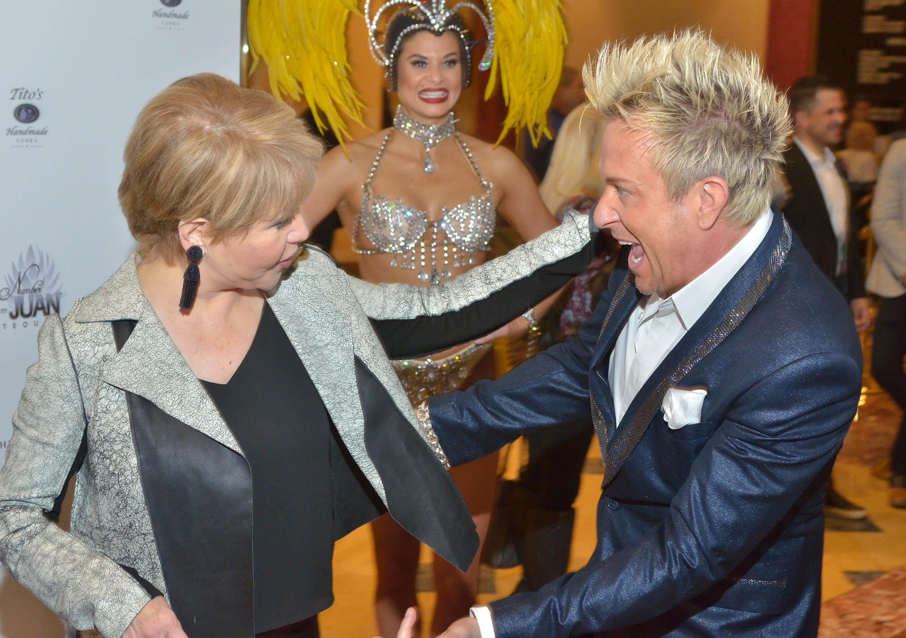 "Pia Zadora, left, and Chris Phillips of Zowie Bowie greet each other at the ""Vegas Cares"" benefit concert at the Venetian Theatre in the Venetian hotel-casino at 3355 S. Las Vegas Blvd in Las Vegas on Sunday, Nov 5, 2017. The concert was sponsored by a group of Las Vegas entertainers, producers and business professionals to honor the victims and first responders from shooting at the Route 91 Harvest festival. (Photo/Las Vegas News Bureau/Bill Hughes)"