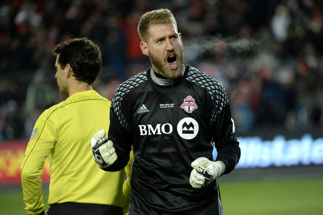 Toronto FC goalkeeper Clint Irwin (1) reacts after making a save against the Seattle Sounders during penalty kicks at the MLS Cup soccer final in Toronto, Saturday, Dec. 10, 2016. (Nathan Denette/The Canadian Press via AP)