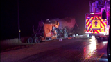 Driver trapped after 18-wheeler crash dies at hospital