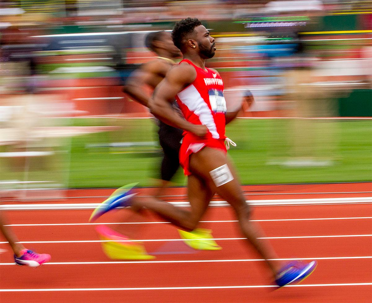 Houston's Cameron Burrell crosses the finish line in heat two of the 100 meter dash. Burrell would win his heat and place second overall in the semi-finals with a time of 9.93. Photo by August Frank, Oregon News Lab