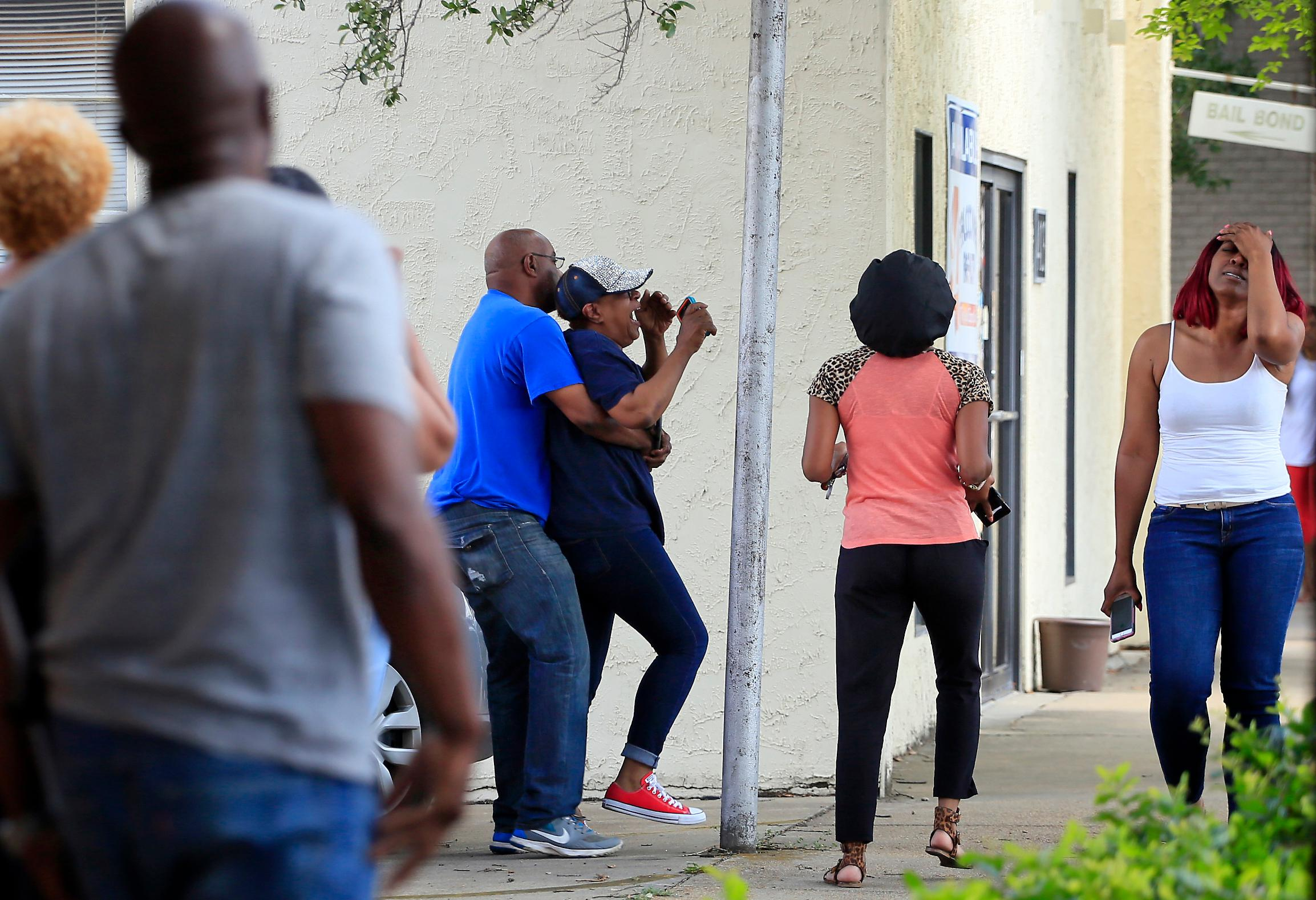 Family members react after finding out the news that Kingston Frazier was found dead after being kidnapped during the theft of his mother's vehicle from a Kroger parking lot Thursday, May 18, 2017, in Jackson, Miss. (Elijah Baylis/The Clarion-Ledger via AP)