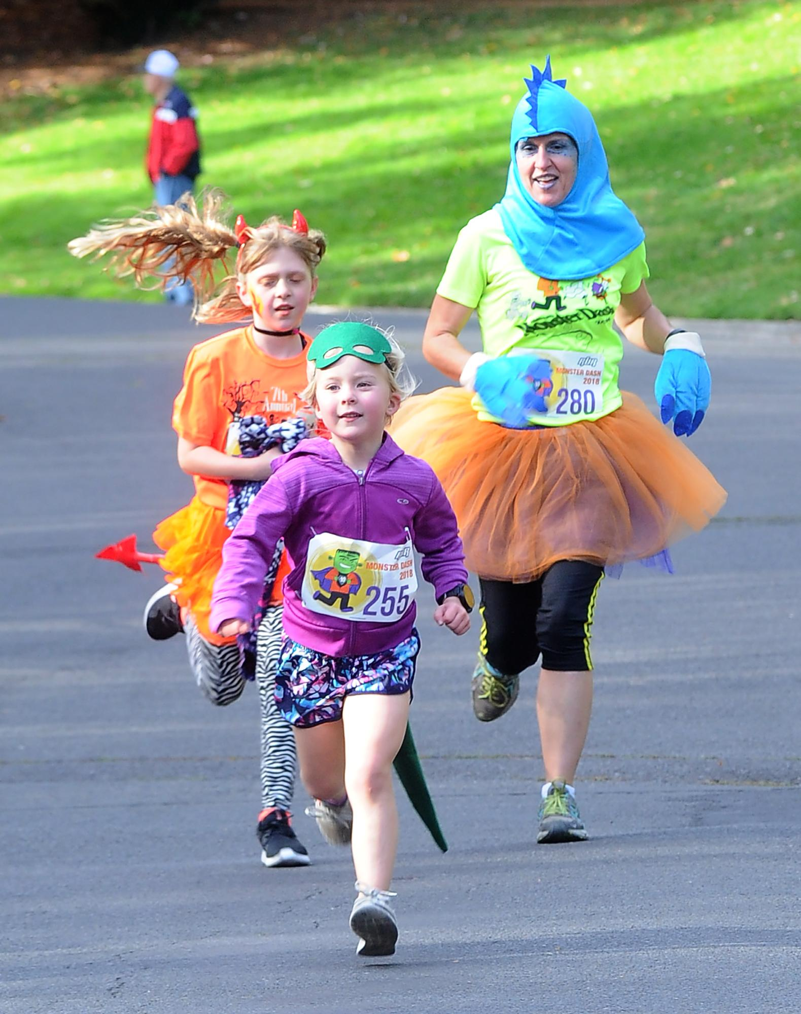 Evelyn McQuown, 5, of Chicago (front) makes her way to the finish line in front of Mia Pickerel, 11, and Venessa Pickerel, both of Ashland, in Saturday's Monster Dash in Lithia Park. Photo by Denise Baratta