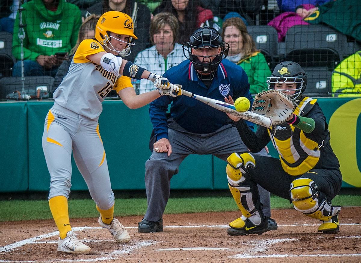 Cal Bears Lindsay Rood (#15) swings for the ball. The Oregon Ducks defeated the Cal Bears 2-1 in game two of a three-game series. Photo by Rhianna Gelhart, Oregon News Lab