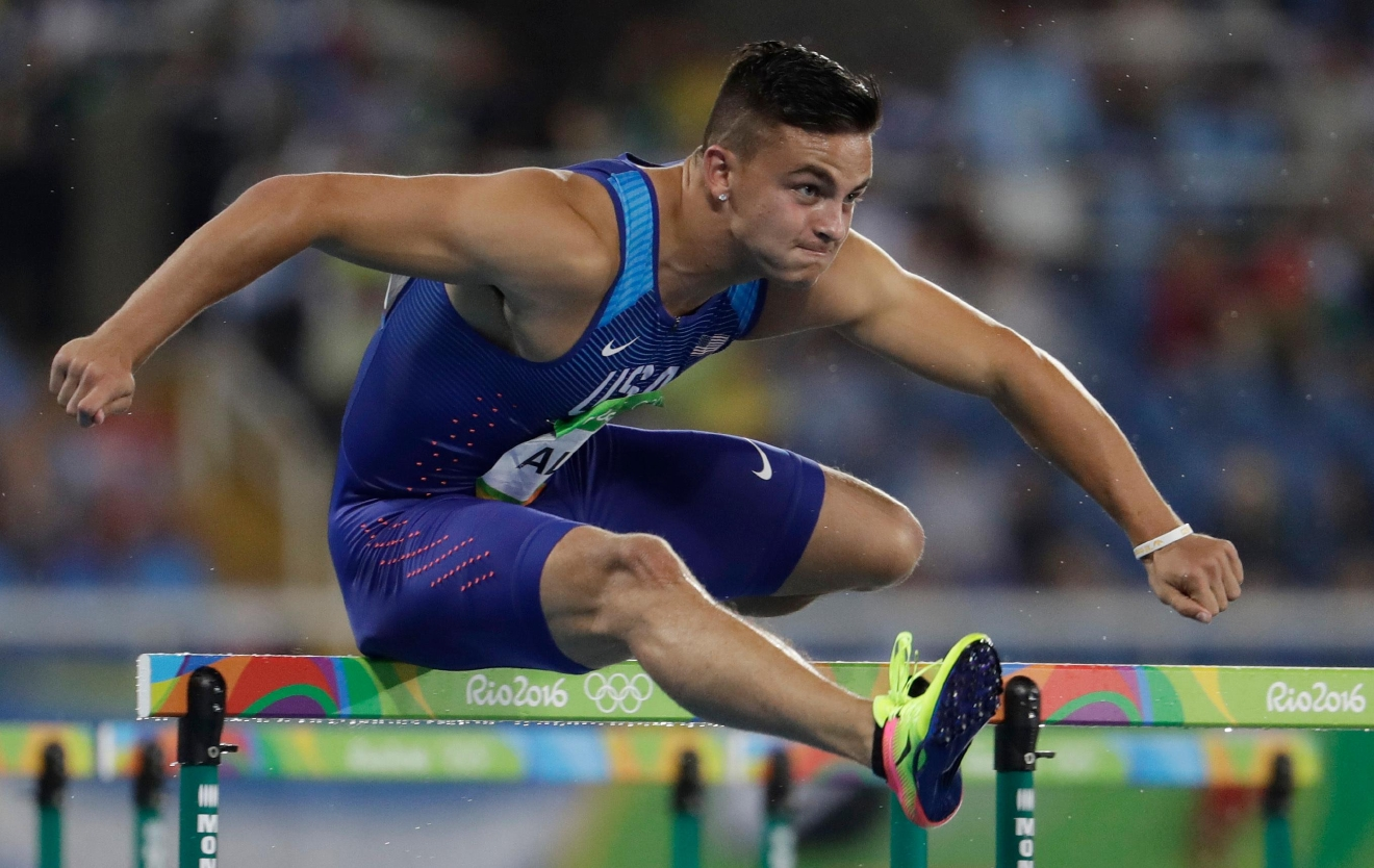United States' Devon Allen competes in a men's 110-meter hurdles heat during the athletics competitions of the 2016 Summer Olympics at the Olympic stadium in Rio de Janeiro, Brazil, Monday, Aug. 15, 2016. (AP Photo/Natacha Pisarenko)