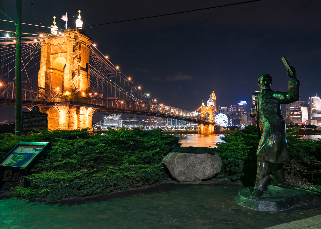 The John A. Roebling statue stands next to the Roebling Bridge. It was installed in 1988 for Cincinnati's Bicentennial. / Image: Phil Armstrong, Cincinnati Refined // Published: 9.24.18