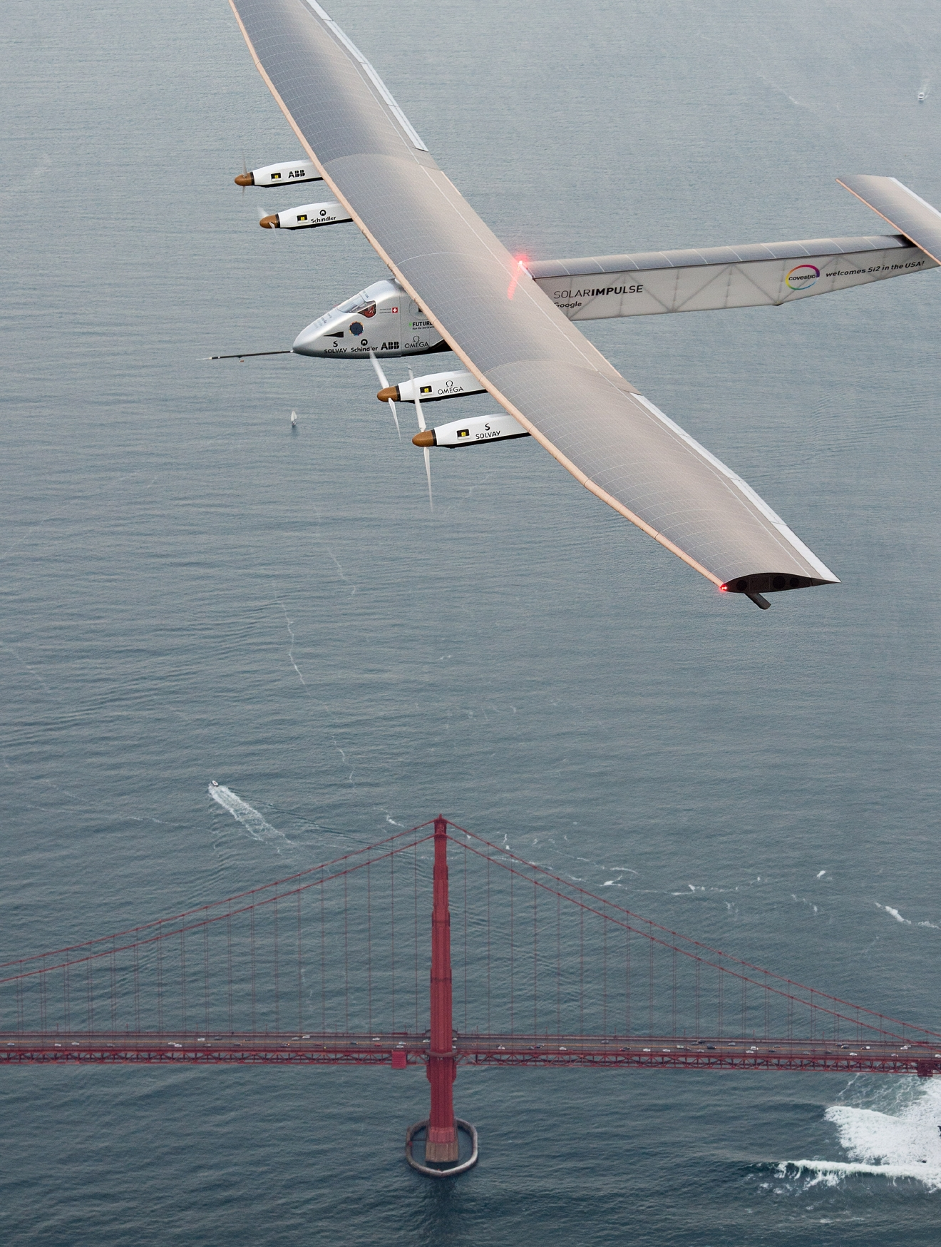 Solar Impulse 2 flies over the Golden Gate Bridge in San Francisco on Saturday, April 23, 2016. The solar-powered airplane, which is attempting to circumnavigate the globe to promote clean energy and the spirit of innovation, arrived from Hawaii after a three-day journey across the Pacific Ocean. (AP Photo/Noah Berger)