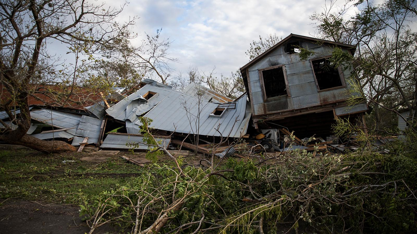 A building sits toppled from Hurricane Harvey in Refugio, Texas, Monday, Aug. 28, 2017. (Nick Wagner/Austin American-Statesman via AP)
