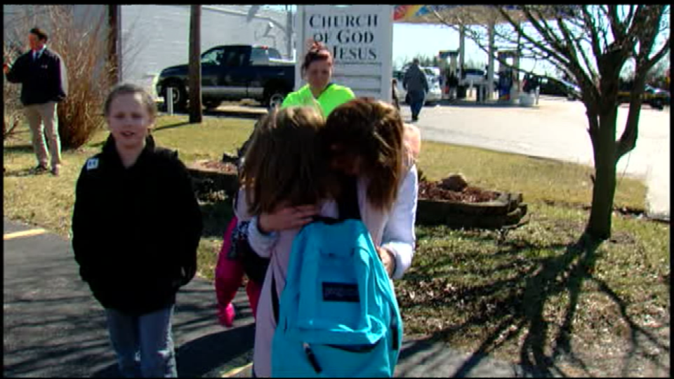 People embrace after shots were fired by a 14-year-old by at students in a high school cafeteria (2.29.16)