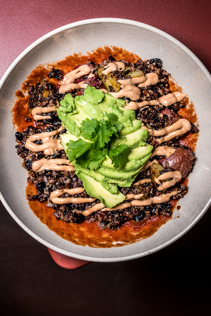 The Sol Bowl: quinoa, rice, chorizo, black beans, potatoes, chimichurri, salsa, cheddar, avocado, cilantro, and chipotle crema / Image: Catherine Viox // Published: 2.10.20