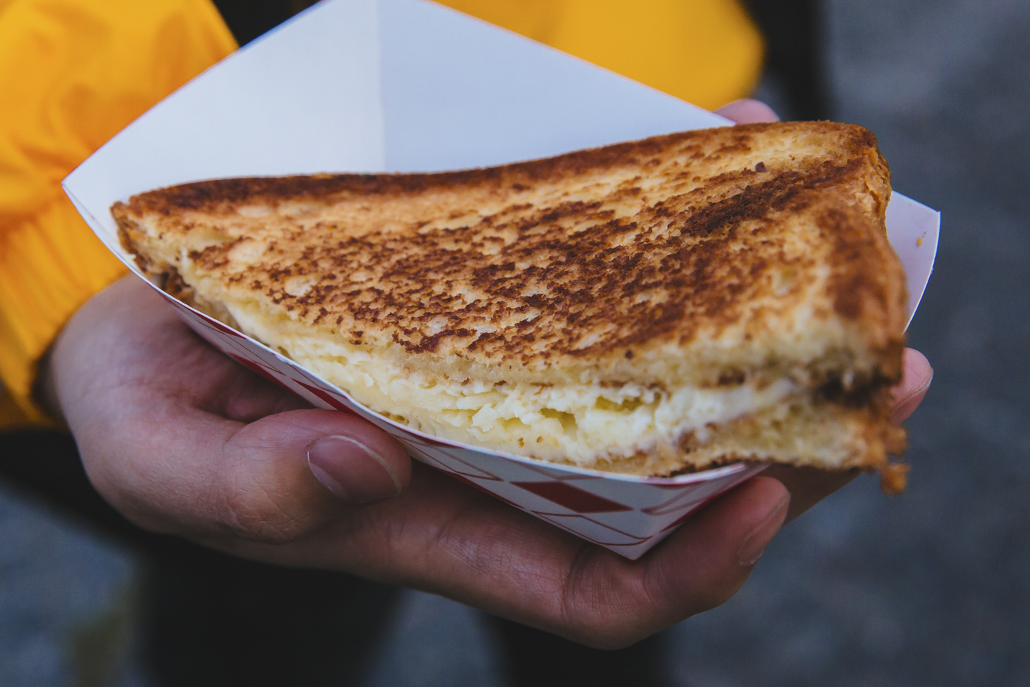 <p>&quot;The White Cheddar Royale&quot; from Bread and Circuses food truck. Truffle Duck Fat Butter, Darigold White Cheddar, Brioche. Seattle's annual Grilled Cheese Grand Prix event kicked off this weekend, properly celebrating April as National Grilled Cheese Month. We went, obviously (for work....) and here were the juiciest sammies on the block we could find. The good news? Pretty much all of these come from brick and mortar stores you can find any time in the city - not just April, and not just t the Grand Prix. (Image: Sunita Martini / Seattle Refined)</p>