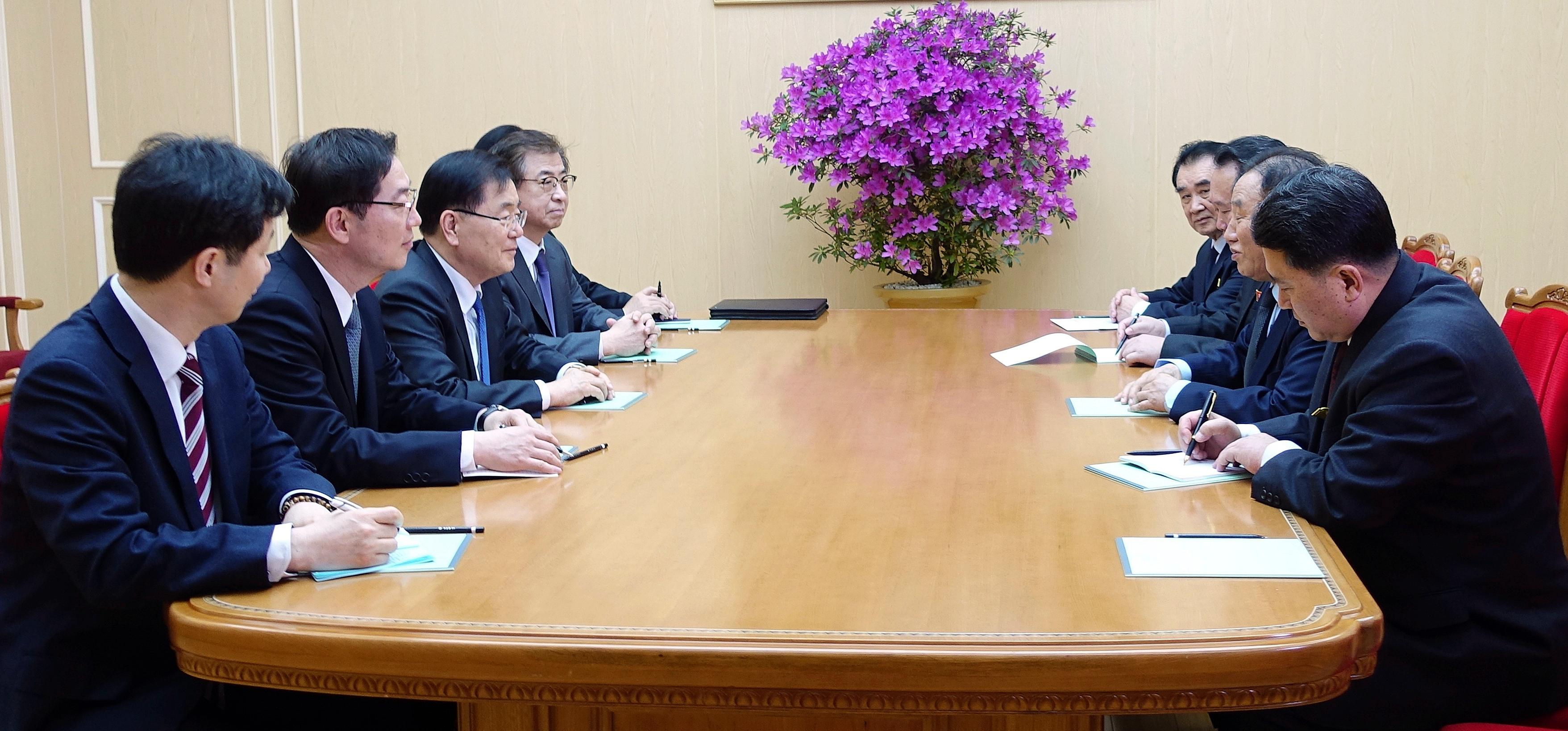 In this photo provided by South Korea Presidential Blue House via Yonhap News Agency, South Korean national security director, Chung Eui-yong, third from left, meets with North Korean vice chairman of North Korea's ruling Workers' Party Central Committee, Kim Yong Chol, second from right, in Pyongyang, North Korea, Monday, March 5, 2018. The envoys for South Korean President Moon Jae-in are on a rare two-day visit to Pyongyang that's expected to focus on how to ease a standoff over North Korea's nuclear ambitions and restart talks between Pyongyang and Washington. (South Korea Presidential Blue House/Yonhap via AP)