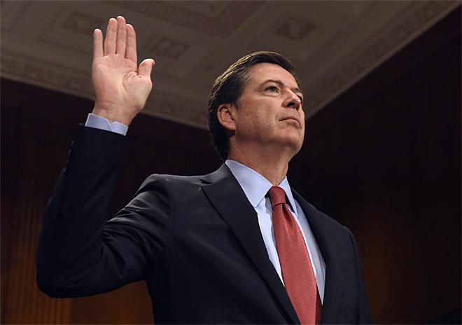 FBI Director James Comey is sworn in on Capitol Hill in Washington, Wednesday, Dec. 9, 2015, prior to testifying before the Senate Judiciary Committee. (AP Photo/Susan Walsh)