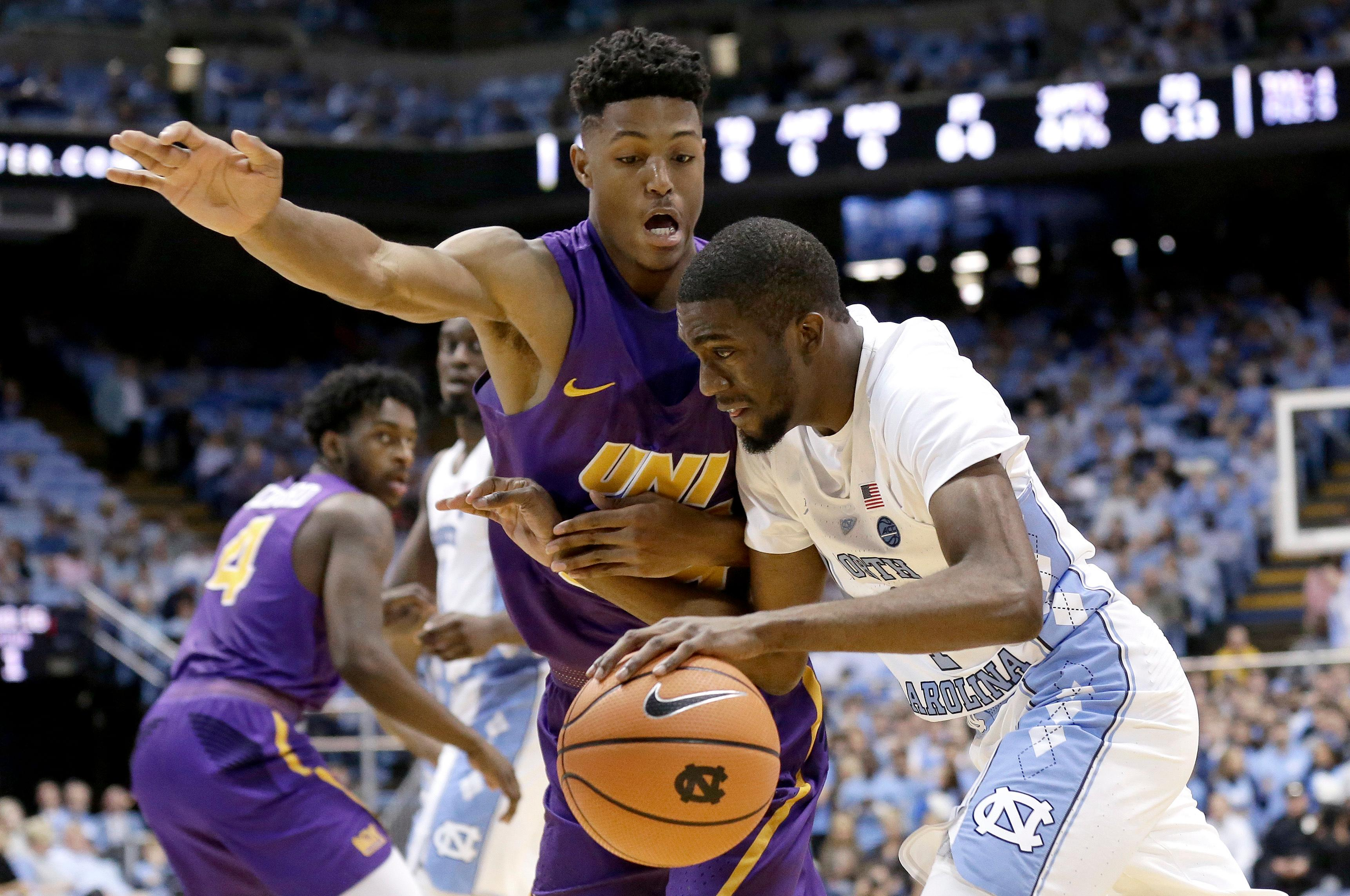 North Carolina's Brandon Robinson drives past Northern Iowa's Isaiah Brown during the first half of an NCAA college basketball game in Chapel Hill, N.C., Friday, Nov. 10, 2017. (AP Photo/Gerry Broome)