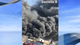 Pallet fire in Fresno releases large black smoke column