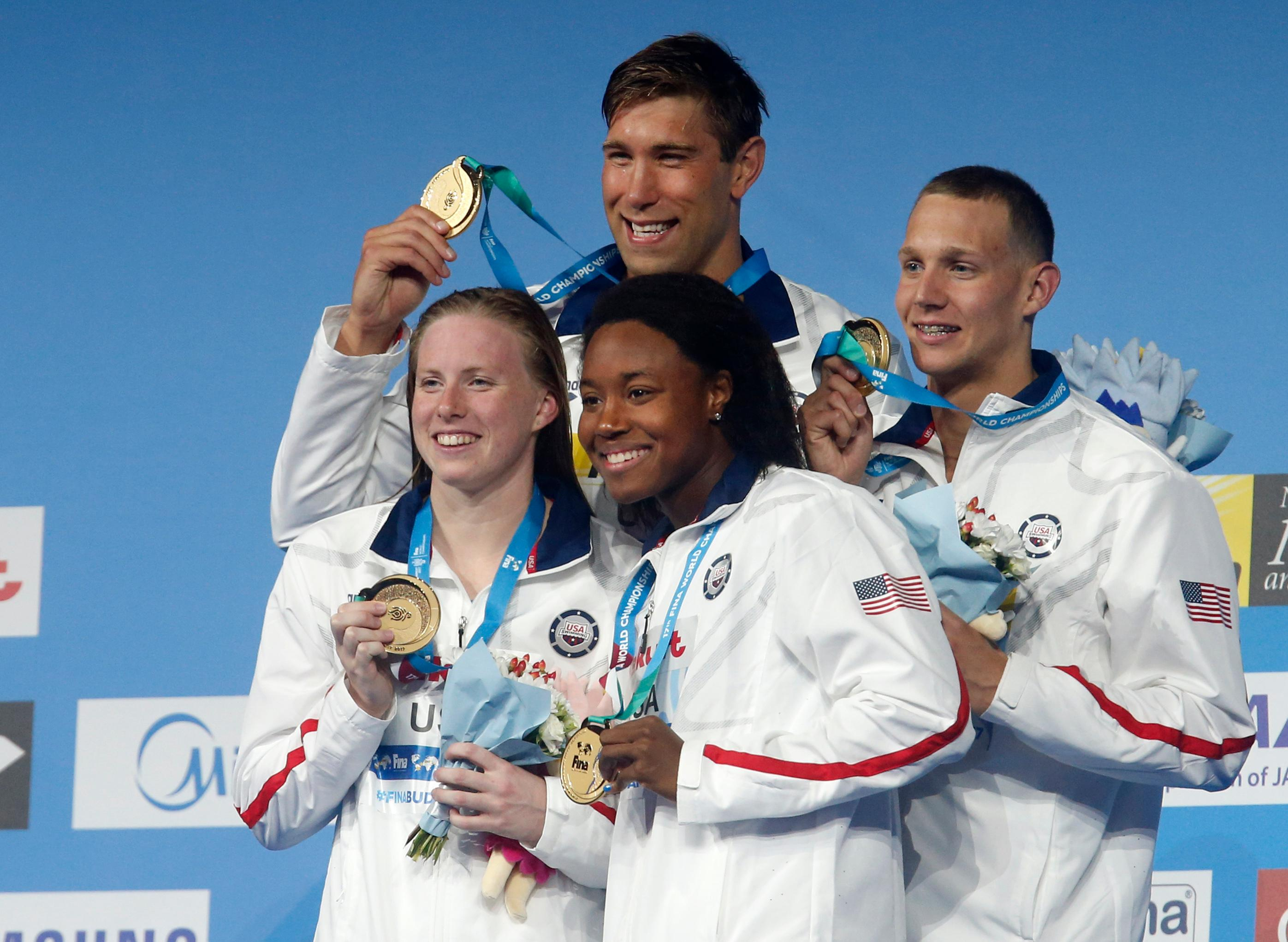 United States' Lilly King, Matt Grevers, Simone Manuel and Caeleb Dressel, from left, pose with their gold medals in the mixed medley relay during the swimming competitions of the World Aquatics Championships in Budapest, Hungary, Wednesday, July 26, 2017.. (AP Photo/Darko Bandic)