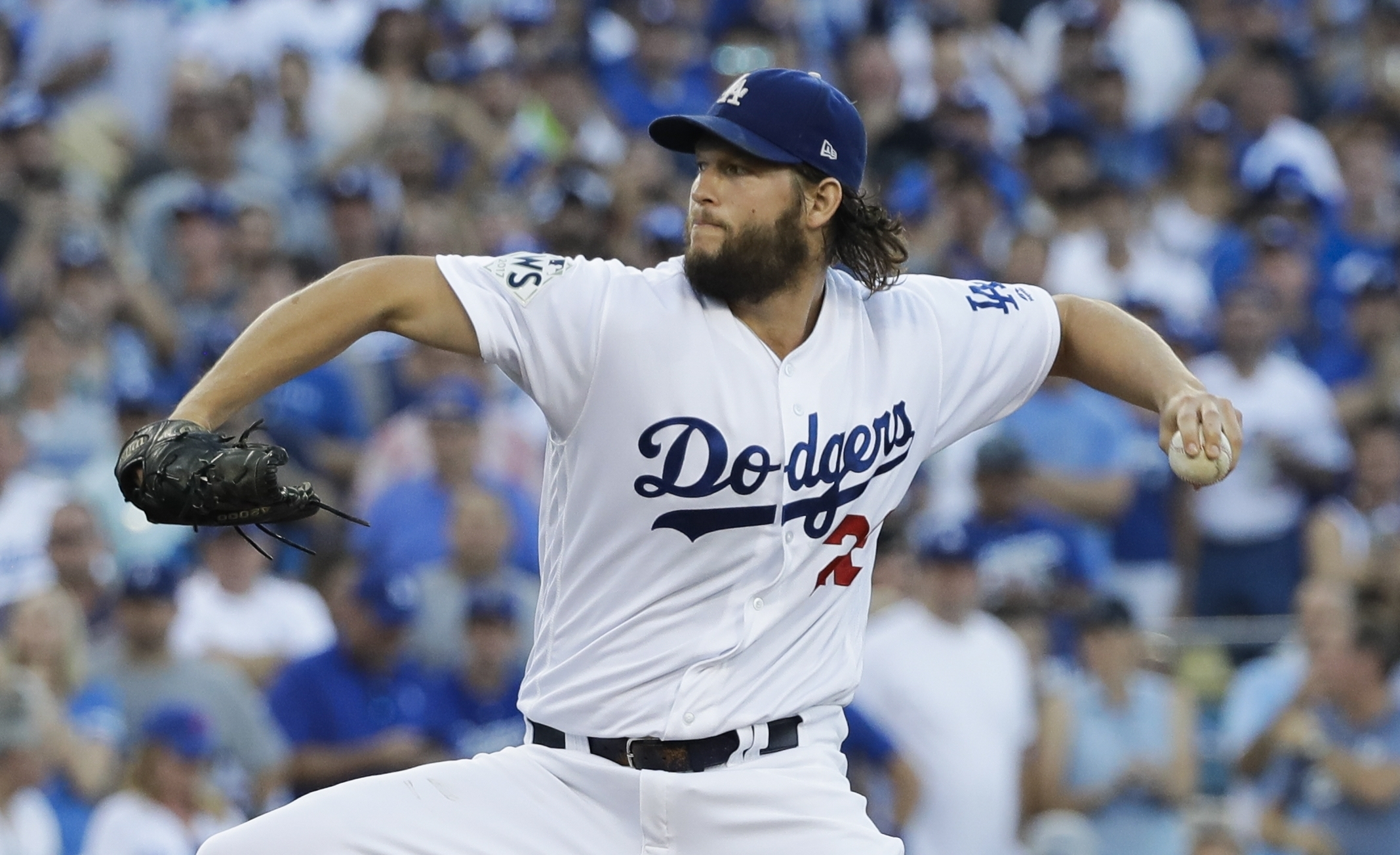 Los Angeles Dodgers starting pitcher Clayton Kershaw throws during the first inning of Game 1 of baseball's World Series against the Houston Astros Tuesday, Oct. 24, 2017, in Los Angeles. (AP Photo/David J. Phillip)