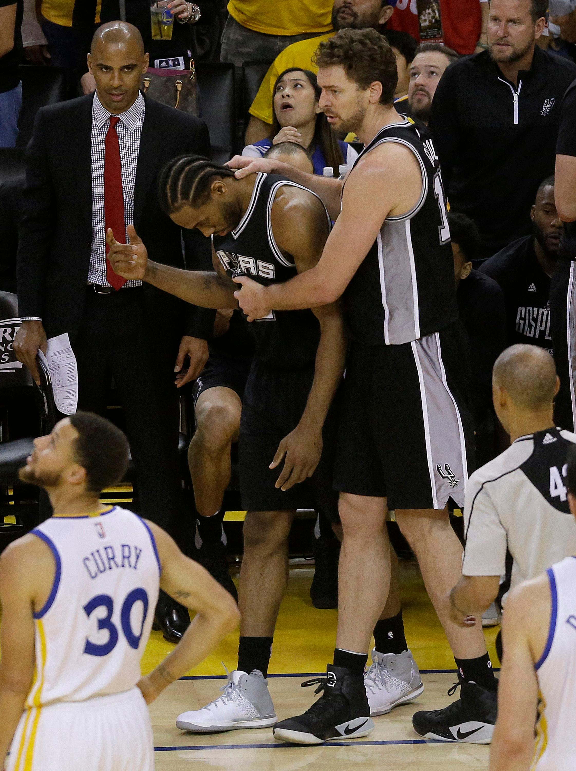 San Antonio Spurs forward Kawhi Leonard, center left, gestures next to center Pau Gasol during the second half of Game 1 of the NBA basketball Western Conference finals against the Golden State Warriors in Oakland, Calif., Sunday, May 14, 2017. The Warriors won 113-111. (AP Photo/Jeff Chiu)