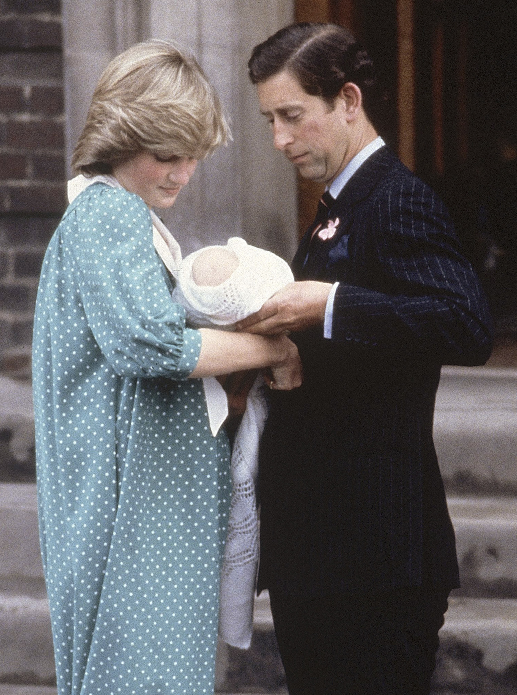 "FILE - In this June 22, 1982 file photo Britain's Prince Charles, and his wife Princess Diana look at their newborn son Prince William, as they leave St. Mary's Hospital, Paddington, London. It has been 20 years since the death of Princess Diana in a car crash in Paris and the outpouring of grief that followed the death of the ""people's princess.""   (AP Photo/John Redman, File)"