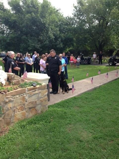 Other members of the K9 unit step up and pay their respects.