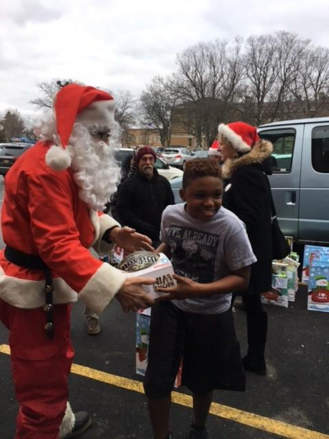This marked the 13th year that Dube brings the gifts over as Santa. This year, he delivered the gifts from his truck. (Photos: Boys & Girls Club)