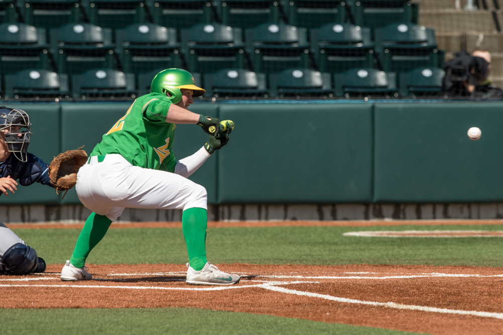 Oregon Ducks outfielder Jake Bennett (#32) sets up for a bunt. In the second of the three game series, the Ducks beat the UC Irvine Anteaters 6-3. Photo by Austin Hicks, Oregon News Lab