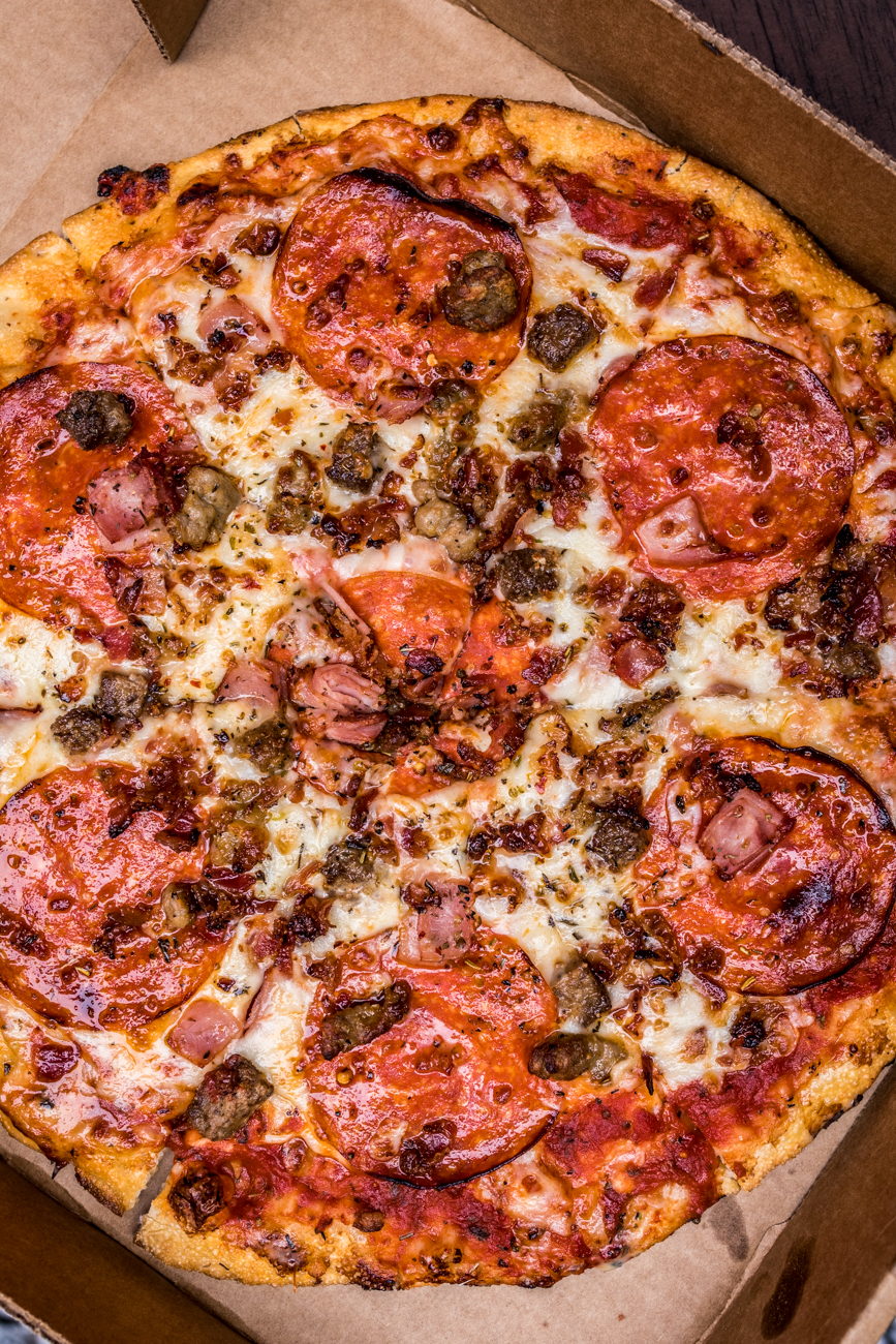 Carne Pizza: loaded with pepperoni, sausage, bacon, ham, and ground beef / Image: Catherine Viox // Published: 4.6.20