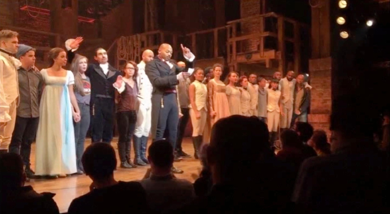 "In this image made from a video provided by Hamilton LLC, actor Brandon Victor Dixon who plays Aaron Burr, the nation's third vice president, in ""Hamilton"" speaks from the stage after the curtain call in New York, Friday, Nov. 18, 2016. (Hamilton LLC via AP)"