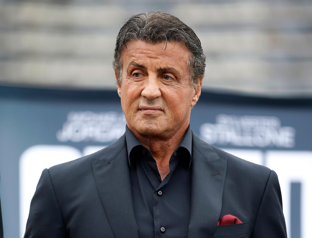 "FILE – In this Nov. 6, 2015, file photo, actor and screenwriter Sylvester Stallone looks on during a news conference promoting the movie ""Creed"" outside the Philadelphia Museum of Art in Philadelphia. Four decades after the Nov. 21, 1976, premiere of ""Rocky,"" the movie's reach is international, and the title character's underdog tale of determination, grit and sleepy-eyed charm still resonates with fans. (AP Photo/Matt Slocum, File)"