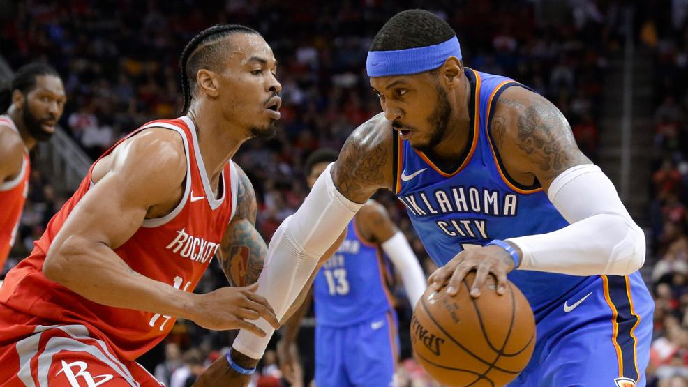 Oklahoma City Thunder Forward Carmelo Anthony  Looks To Drive Around Houston Rockets Guard Gerald Green  During The First Half Of An Nba Basketball