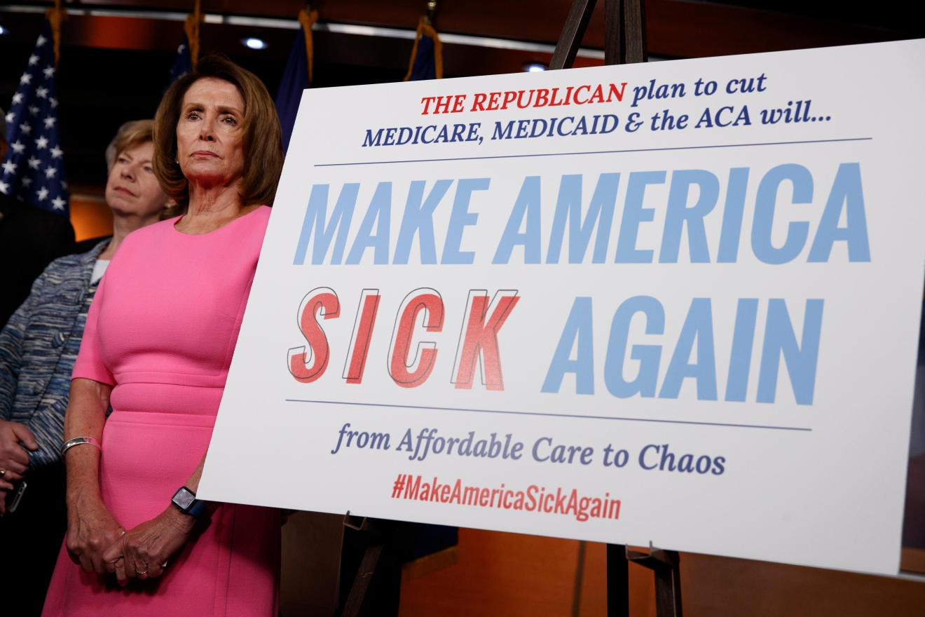 House Minority Leader Nancy Pelosi of Calif., and Sen. Tammy Baldwin, D-Wis. listens during a news conference on President Barack Obama's signature healthcare law, Wednesday, Jan. 4, 2017, on Capitol Hill in Washington. (AP Photo/Evan Vucci)